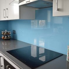 Azure Sky Kitchen Glass Splashback by CreoGlass Design (London,UK). View more toughened glass splahback designs and non-scratch worktops on www.creoglass.co.uk #kitchen #backsplash