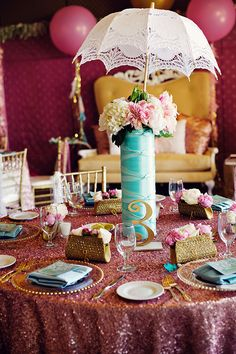 Love the umbrella in this stunning bridal shower centerpiece!