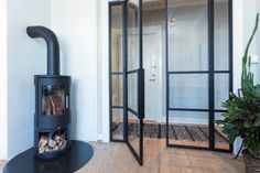 Jerndører med glass | Myhre Smie Wood, Glass, Home, Home Appliances, Wood Stove