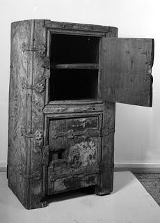 St. Thomas guild - medieval woodworking, furniture and other crafts   Armoire with iron hasps and hinges from Ukjent Fylke dating from the late Middle Ages. The front posts are attached to the sides with eight iron fittings, of wich four extend to the two doors (39 by 30 cm). The doors are opened by spade shaped iron rings. Height 96 cm, width 53 cm, depth 35 cm. On the outside are traces of white and blue paint.