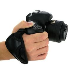 eForCity Heavy Duty Camera Hand Strap, Black by eForCity. $2.23. Cushioned camera grips fits around your hand and stabilizes your camera / camcorder while shooting / filming. Secure mounting design firmly mounts onto your camera base. Adjustable strap and micro-fiber padding ensures a solid and comfortable grip. One size fits all, adjustable strap. Color: Black. Accessory ONLY. Camera not included. Compatible with: Nikon / Canon / Pentax / Minolta / Fuji