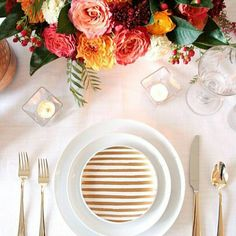 Love this Clean, modern table setting in white with gold stripes. Also love the brightly coloured flowers via @littlegraystation