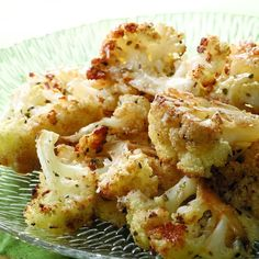 Roasting isn't usually the first cooking method you think of for cauliflower but the results are quite delicious. The florets are cut into thick slices and tossed with extra-virgin olive oil and herbs. Wherever the flat surfaces come into contact with the hot roasting pan, a deep browning occurs that results in a sweet, nutty flavor.