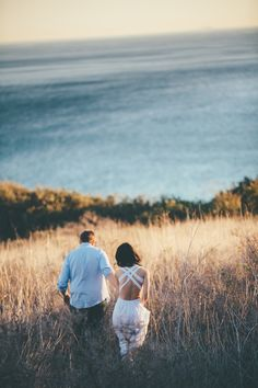A romantic beach engagement session, shot at El Matador, State Park, in Malibu California.  By Bright Bird Photography (www.brightbirdphotography.com)