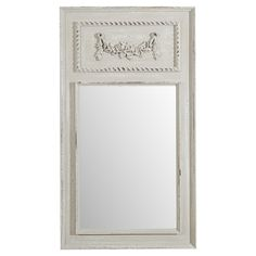 Wall mirror with a distressed frame and raised floral embellishment.  Product: Wall mirrorConstruction Material: