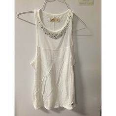 Hollister White Mesh Tank With Jewels This tank is super cute and has a mesh panel on the front lined with sparkles. Hollister Tops Tank Tops