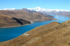 One of the holiest lakes in Tibet Horrible People, Tibet, Lakes, Mountains, World, Travel, Viajes, Trips, Traveling