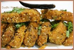 Here is a very famous Gujarati tea-time healthy snack Dudhi Na Muthiya that is sure to please you. Muthi means fist in Guajarati, and the dish is named such because the mixture is shaped into cylindrical rolls using the fist. One thing to remember while making doodhi na muthia is that bottle gourd has high water content. This water itself is sufficient to impart softness to the Muthias, and it is not necessary to add any more water while making the dough.