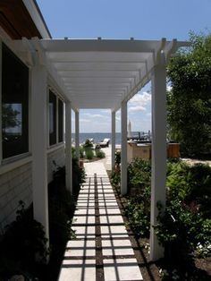 Pergola covered walkway. Along garage? It would be nice to walk from the car to the house without getting soaked.