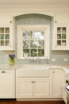 I feel like a stainless steel farmhouse sink would pop more! Kitchen backsplash GREEN with Envy: LEED Certified Whole House Renovation - traditional - kitchen - dc metro - Harry Braswell Inc. House Of Turquoise, Turquoise Kitchen, Kitchen Redo, New Kitchen, Kitchen Backsplash, Backsplash Ideas, Blue Backsplash, Backsplash Design, Kitchen Fixtures