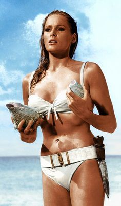 """Happy Birthday, Bikini! In Honor of the Invention of the Two-Piece, Here Are the Most Iconic Bikinis in History: The scene in 1962's Dr. No--the first ever James Bond flick--where Ursula Andress emerges from the sea in a white bikini, helped define the quintessential """"Bond Girl."""""""