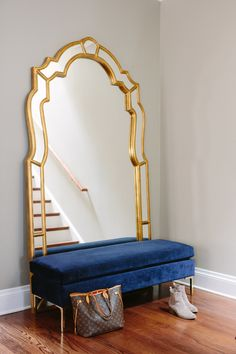 A grand floor mirror and velvet bench add sophistication and luxury to bottom of their staircase. Home Bedroom, Bedroom Decor, Decor Interior Design, Interior Decorating, Foyer, Entryway, Room Goals, Floor Mirror, Floor Decor