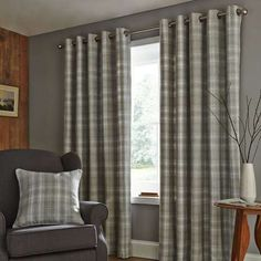 Crafted from a brushed effect fabric with a classic grey checked pattern, these woven curtains feature an eyelet header and are available in a choice of sizes....