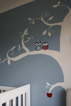 Buy a wall decal or hire someone to hand paint a tree???