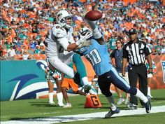 Tennessee Titans cornerback Jason McCourty (30) blocks a pass intended for Miami Dolphins wide receiver Brian Hartline (82) during the second half at Sun Life Stadium. Tennessee won 37-3.  Steve Mitchel, US Presswire