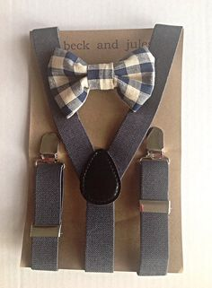 Little boys dark grey/navy suspenders with a plaid matching clip on bow tie. Suspenders come in only one size but have adjusters and are made of