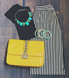 Black top + black & white striped maxi skirt & pops of color in the accessories