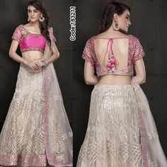 Crafted in hues of #pink, this light-weight #Silk #Lehenga is great find your sangeet night!!    #DesignerBlouse #FloralMotif #Volume #Layers #Embroidery #Designer #Occasion #IndianDresses #Partywears #Indian #Women #Bridalwear #Fashion #Fashionista #OnlineShopping