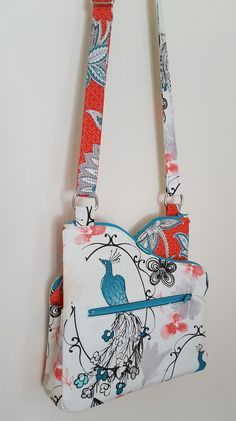 """Pattern Difficulty: Intermediate==========Dimensions: Approximately 10""""x 10""""x 2.25"""" at tallest and widest points.==========Zip-To-It is the perfect little crossbody bag for the fabric obsessed!! She is designed to be used with a fabric pair on the exterior, so that you can put your own personal style and aesthetic into it. The curved zipper tops give it a funky, eye-catching design.Zip-To-It is composed of three separate compartments. The two sides are each a zippered pouch with slip…"""