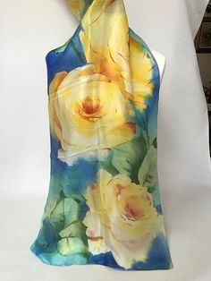 SILK SCARF WITH LIGHT BROWN AND YELLOW ROSES Material:HABOTAI-100%NATURAL SILK Dimensions: 61.4 x 17.7 inches = 156CM X 45CM Motif:Light brown and Yellow Roses with Green Leaves on marbled blue background. Technique:Impressionistic watercolor. ****************** I paint directly on silk an