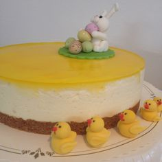Easter Cheese cake with lemon, lime and orange and fondant decorations and chocolate eggs.