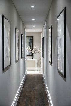 Modern contemporary hallway design and decor. Grey hallway walls, hardwood floors and bright LED recessed lighting. Hanging pictures in a narrow hallway. Hallway Walls, Hallway Wall Decor, Hallway Lighting, Entryway Decor, Modern Entryway, Entryway Ideas, Grey Hallway, Hallway Paint Colors, Narrow Entryway