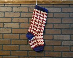 This beautiful hand knit striped Christmas stocking is ready for Santa to fill with goodies. It features a dark blue cuff, heel and toe with light