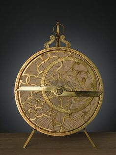 """Astrolabe planisphère    Asne Michel (2e moitié 16e siècle-début 17e siècle)orfèvre à Caen      (C) RMN / René-Gabriel Ojéda    @credits    An astrolabe (Greek: ἀστρολάβον astrolabon, """"star-taker"""") is an elaborate inclinometer, historically used by astronomers, navigators, and astrologers. Its many uses include locating and predicting the positions of the Sun, Moon, planets, and stars, determining local time given local latitude and vice-versa, surveying, triangulation, and to cast horoscop"""