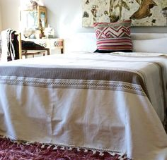 This fabulous queen size cotton blanket is from Southern Mexico. Made using a traditional loom these stunning coverlets have a delicate look and are finished by hand with tassels. Perfectly puddles onto the floor of a queen bed and will work as a layering piece for a king bed! #blanket #global #textile
