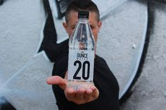 Theo Rossi showing off, a bottle of his 20 ounce Ounce Water. 💧🍶👑