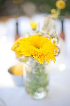 A single yellow flower serves as a centerpiece. Gorgeous in its simplicity. Crash Entertainment, West Hollywood wedding DJ.