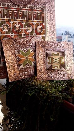 What a unique idea of mixing metal and fabric! A beautiful copper frame with fabric center cross stitched with Palestinian embroidery. دمج فن النحاس مع التطريز