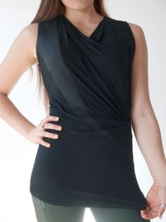 Black draped tunic top that combines style with comfort. Modern silhouette constructed of super soft jersey and eco-friendly Tencel. As easy to move in as your favorite fitness and yoga wear. Great for office, street or an evening out. By Erin Draper.