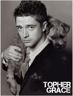 Topher Grace holding a dog. If he were wearing glasses, it would be the perfect picture.