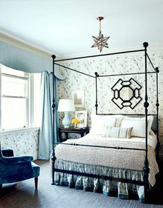 """bedroom with Rose Tarlow's """"Bamboo"""" wallpaper. black iron canopy bed, blue, white, grey, and beige neutral room. ...I LOVE A ROOM WITH BLUE CEILINGS!!! i think the light blue ceilings help anchor the wallpaper and help give the design some weight. i also love the bed. blue velvet wingback chair. glass star pendant lantern"""
