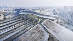 UK studio Zaha Hadid Architects has designed a 46-metre-wide bridge with a curved timber roof for Vilnius railway station in Lithuania as part of a renovation project called Green Connect. Ecuador, Timber Roof, Neoclassical Architecture, Timber Structure, Bridge Design, Zaha Hadid Architects, Chongqing, Design Competitions, Architect Design