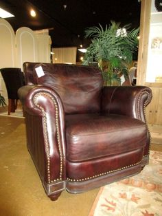 """A very distinguished look with this chocolate leather chair with nail head trim.  This item measures 39"""" L x 38"""" W x 36"""" H. Arrived: Tuesday September 27th, 2016"""