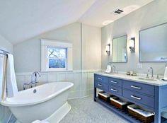 Grey vanity, marble counter, freestanding tub