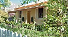 Dalton Cottage Orange, a Orange House Orange Country, Orange House, Country Lifestyle, Country Charm, Old World, Outdoor Decor, Plants, Barns, Cottages