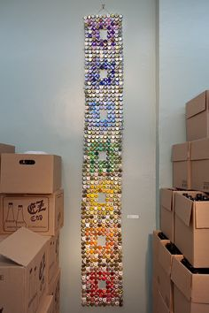 """Happy Earth Day! """"Salvaged Chakras"""" bottle cap tapestry - 672 used bottle caps sewn together with steel wire. approximately 7' x 1'  Now available on Etsy: http://www.etsy.com/listing/98140050/salvaged-chakras-bottle-cap-tapestry"""