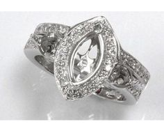 an elegant vintage inspired set features a marquise mounting that ...