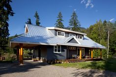 """Designed as a prefabricated """"kit"""", this unique family mountain home was delivered in pieces and assembled on our clients' property."""