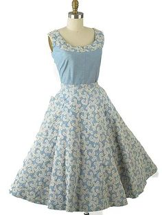 <p>Looking for a vintage summer outfit with some serious wow factor? This authentic 50s two piece dress set is sure to garner compliments wherever you wear it. Made in the lightest weight light blue denim, this skirt and top have eyecatching design details of intricate embroidery, rhinestone and pearl bead accents. Very versatile as you wear the separates with other items in your wardrobe to create different looks. Pair with a white belt, lace up espadrille wedge sandals, a straw bag an...