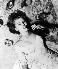 Sophia Loren. Drinking.
