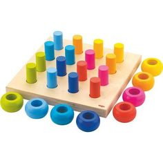 HABA Palette of Pegs - 32 Piece Wooden Pegging & Arranging Game for Ages 2 and Up Wooden Pegs, Wooden Puzzles, Organic Baby Wipes, Social Skills Games, Kids Toys Online, German Toys, Water Based Stain, Stacking Toys, Games For Toddlers