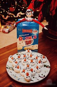Day 8: Snowman Donuts - North Pole Playground.  I don't get the elf on the shelf thing but I think this would be a cute thing to make with kids or take to a party.
