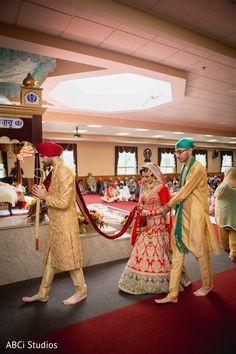 Sikh couple surrounding in circle the Guru Granth Sahib Ji. https://www.maharaniweddings.com/gallery/photo/140728