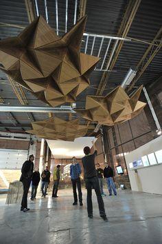 Adaptive acoustics: moveable origami ceiling panels