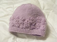 Ravelry: Little Posy Snug Hat pattern by Sublime Yarns