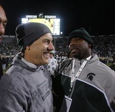 Julian H. Gonzalez/DFP Michigan State head football coach Mark Dantonio gets a hug from former basketball player Mateen Cleaves after MSU's 29-6 win over Michigan in football in East Lansing on Saturday, November 2, 2013.